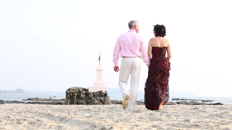 man with a woman walk along the beach Footage