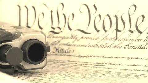US Constitution with Hand Gun - Right To Keep and Stock Video Footage