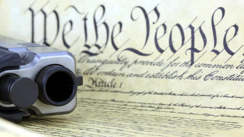 US Constitution With Hand Gun - Right To Keep And  stock footage