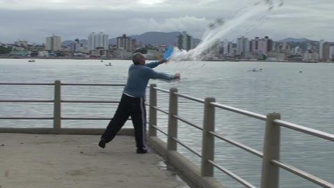 027 Florianopolis , fisherman throw his net in sea Stock Video Footage