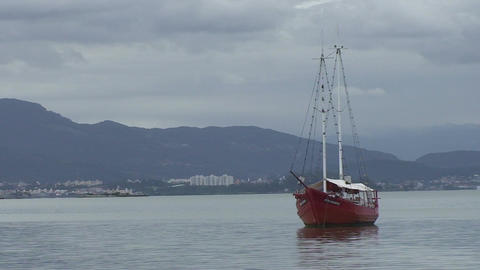 034 Florianopolis , red boat in sea Stock Video Footage