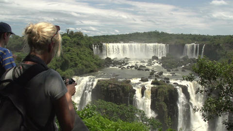046 Iguazu waterfalls , woman take pictures of wat Stock Video Footage
