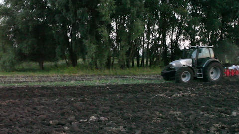 Tractor plowing the black earth plow field at suns Footage
