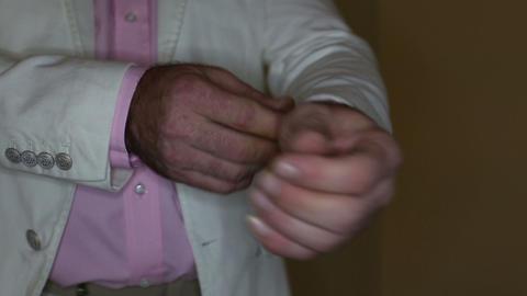 man adjusts his cufflinks Footage