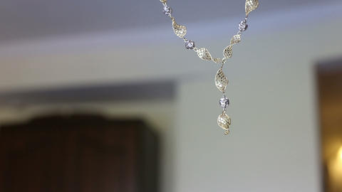 necklace show on wall Stock Video Footage