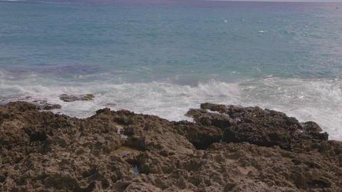 slow motion kenting ocean waves crashing on rocks Footage