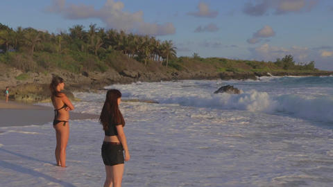 girls enjoy sun at baisha white sand bay beach Footage