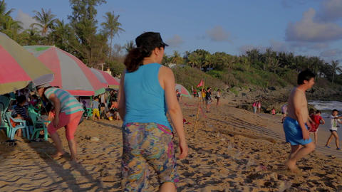 people under umbrella's at baisha white sand bay b Footage