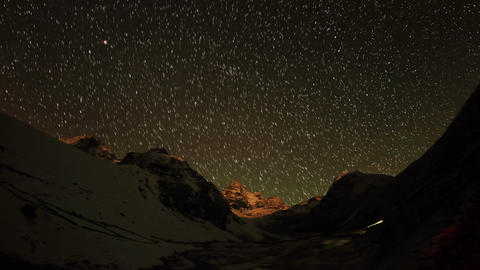 Time lapse of stars behind mountains Kyajo, Pharil Stock Video Footage