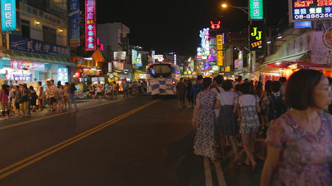 Pingtung Night Market - people walking in the nigh Footage