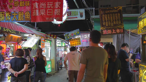 Ruifeng night market - people walking away from ca Live Action