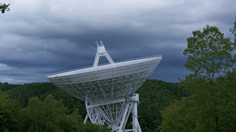 4k UHD large radio telescope dark clouds 11478 Footage