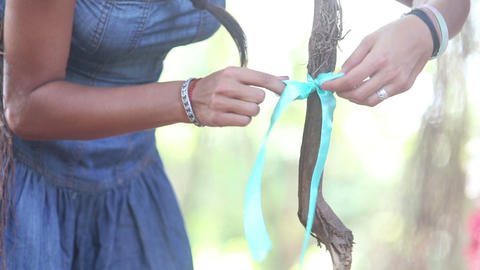 girl decorator tying ribbons on the branches Footage