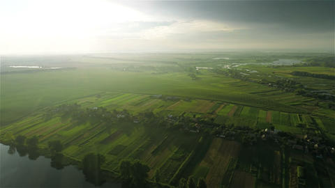 Village and fields with a bird's-eye view on sunse Stock Video Footage