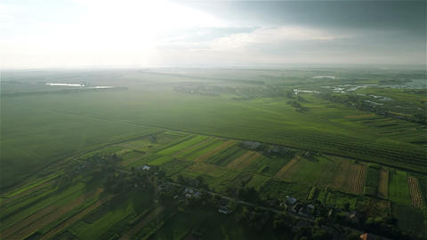 Village and fields with a bird's-eye view on sunse Footage