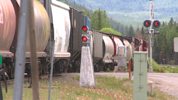 HD2008-6-7-8 hopper mixed train leaving slow Stock Video Footage