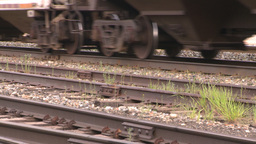 HD2008-6-7-10 cu wheels and rail train leaving slow Footage
