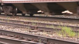 HD2008-6-7-10 cu wheels and rail train leaving slow Stock Video Footage