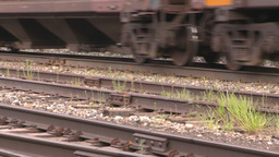 HD2008-6-7-10 cu wheels and rail train leaving slow Stock Video Footage