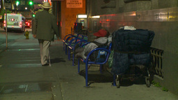 HD2008-6-8-21 dusk Calgary DT homeless and shopping cart Footage