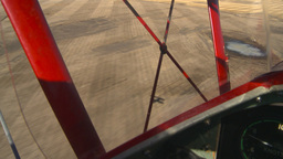 HD2008-3-1-17 Red biplane aerial wing left shadow Footage