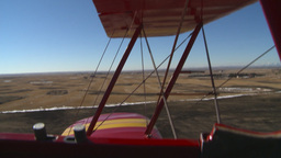 HD2008-3-1-19 Red biplane aerial wing left touch n go Footage