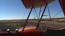 HD2008-3-1-19 Red biplane aerial wing left touch n go Stock Video Footage
