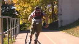 HD2008-10-1b-2 rollerblader on bike path autumn Stock Video Footage