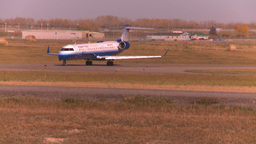 HD2008-10-2-45 united RJ jet taxi thru frame Footage