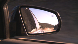 HD2008-10-3-14 drive on mtn road side mirror Stock Video Footage