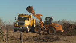 HD2008-10-10-1 Front end loder an dump truck Stock Video Footage
