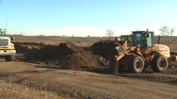 HD2008-10-10-5 Front end loder an dump truck Stock Video Footage