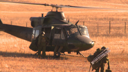 HD2008-10-11-4 heli idle troops out Stock Video Footage