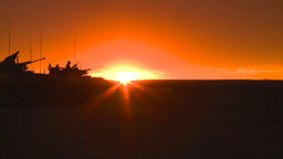 HD2008-10-11-20 silou LAV sunset soldier LAV drives off Stock Video Footage