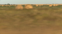 HD2008-9-3-46 drive wheat fields hay rolls Stock Video Footage