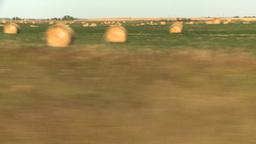 HD2008-9-3-46 drive wheat fields hay rolls Stock Video Footage