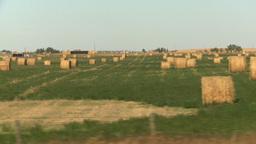 HD2008-9-3-48 drive wheat fields hay rolls Stock Video Footage