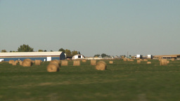 HD2008-9-3-48 drive wheat fields hay rolls Stock Video Footage