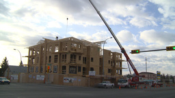 HD2009-4-1-30 condo construction site 120ton crane Stock Video Footage