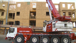 HD2009-4-1-32 condo construction site 120ton crane Stock Video Footage