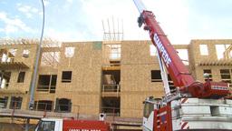 HD2009-4-1-32 condo construction site 120ton crane Stock Video Footage