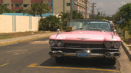 HD2009-4-7-38 Cuba pink caddy taxi Stock Video Footage