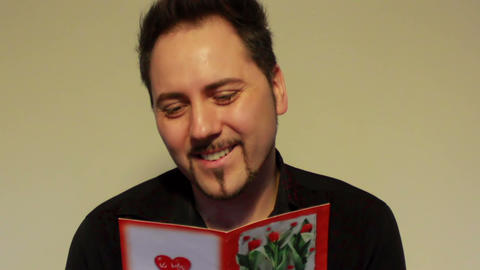 Man Reads A Valentine's Day Card With Esteem stock footage