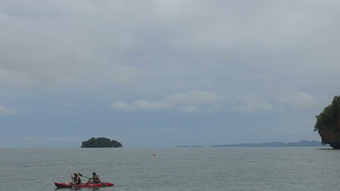 people floating in a kayak island Stock Video Footage