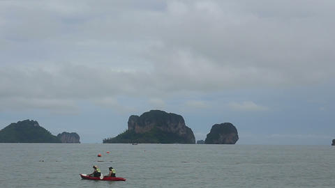 people floating in a kayak island Stock Video Footage