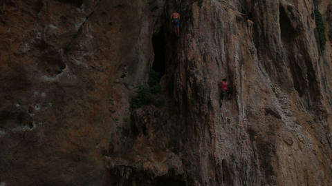 Climber Climbing A Cliff With Insurance stock footage