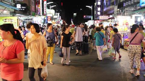 Liuhe Night Market - people walking towards camera Footage
