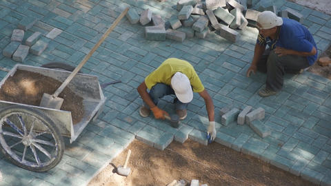 Two workers are built sett Stock Video Footage