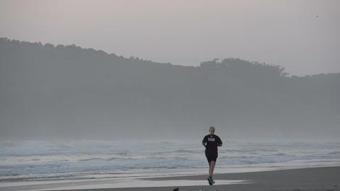 031 Laguna , Sunrise at the beach , running woman Footage