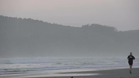 031 Laguna , Sunrise at the beach , running woman Stock Video Footage